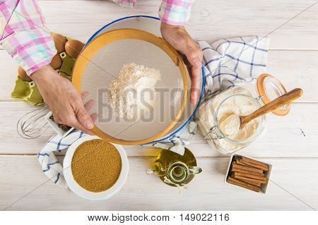 Cook Woman Sieving Flour With Her Hands