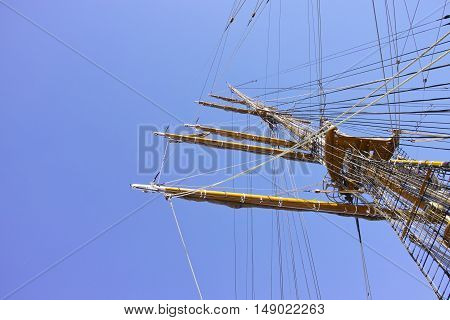 detail of a wooden mast against blue sky