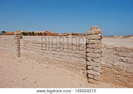 Brick Fence Wall At Sand On Egypt