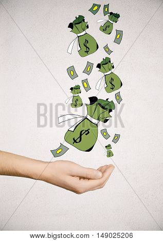 Hand holding creative dollar bags and banknote sketch on light background. Wealth concept