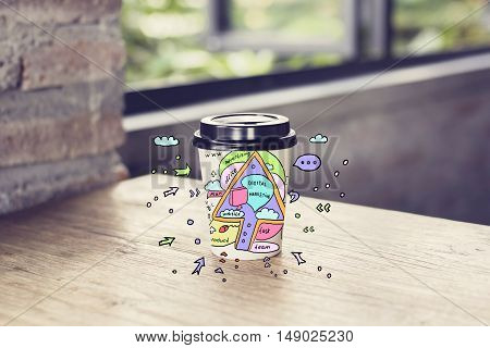 Take away coffee cup with creative digital marketing sketch on wooden table