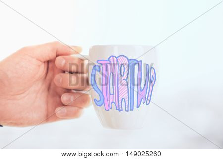 Male hand holding coffee cup with creative purple startup sketch. Start up concept