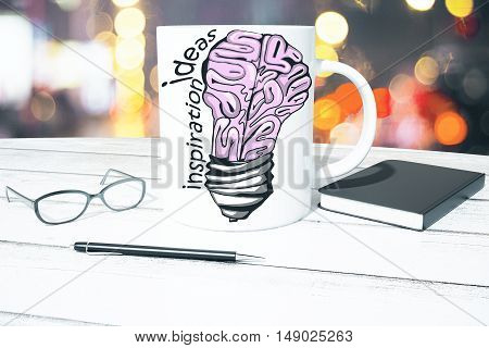 Workplace with creative human brain lamp sketch on coffee cup glasses pen and notepad on bokeh background. Brainstorming and inspiration concept. 3D Rendering