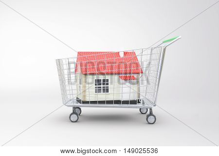 Trolley with red house on light background. Concept of buying property. 3D Rendering