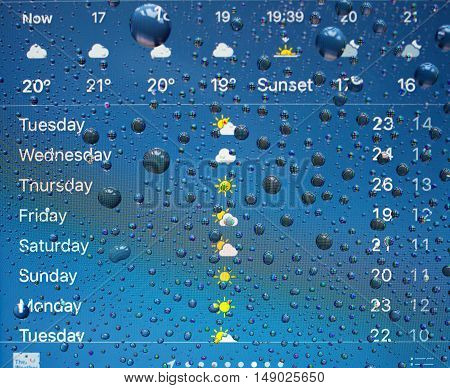 PARIS FRANCE - SEP 26 2016: New Apple iPhone 7 Plus unboxing and testing - weather app on iPhone screen with forecast. New iPhone7 is one of the best waterproof smart phone in the world