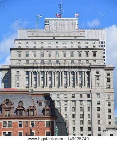 MONTREAL QUEBEC CANADA 09 23 2016: Sunlife building in Montreal canada.The Sun Life Building is an historic office building at 1155 Metcalfe Street. Place ville Marie in background.