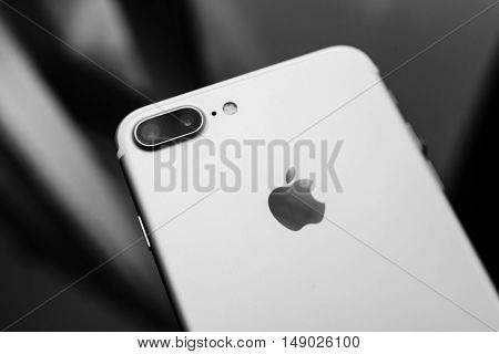 PARIS FRANCE - SEP 26 2016: New Apple iPhone 7 Plus unboxing and testing - black and white phone on glass background . New iPhone7 is one of the best waterproof smart phone in the world