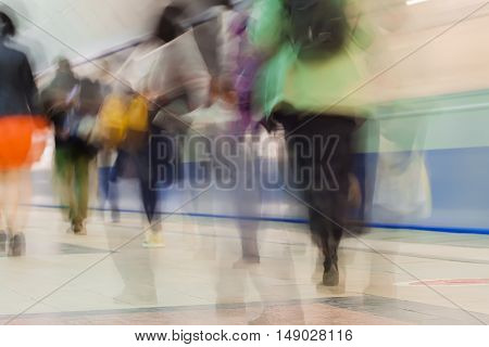 Abstract blurred subway for background . Crowd of people walking along the station platform