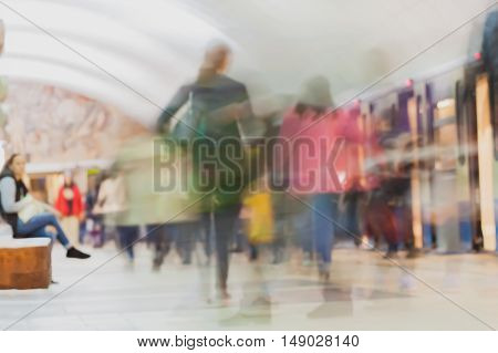 Underground station. Adults and children go along the station platform. Abstract blurred subway for background