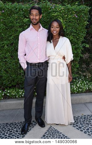LOS ANGELES - SEP 25:  Alfred Enoch and Aja Naomi King arrives to The Rape Foundation Annual Brunch on September 25, 2016 in Beverly Hills, CA