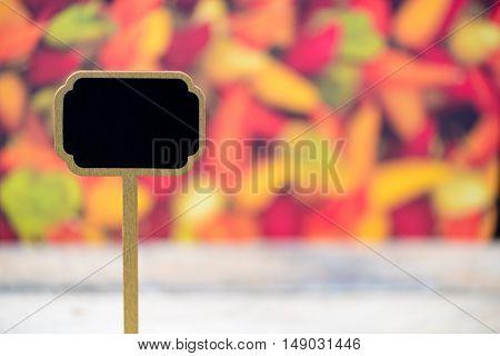 Wooden Mini Blackboard Label Over Chilli Peppers Background