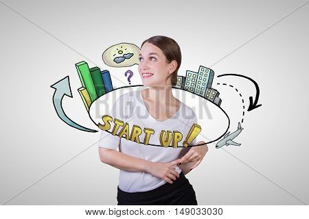 Gorgeous young lady with abstract circular start up sketch on light background. Startup concept