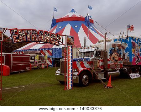 The American circus. Forfar, Scotland - September 13, 2016 American circus and a large truck transport on the square in the Scottish town of Forfar.