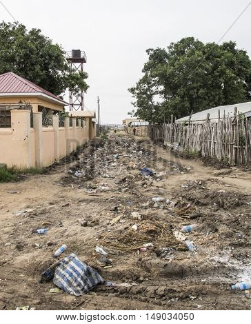 Trash fills a dirt road in Juba, capital city of South Sudan