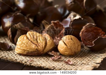 Freshly roasted or baked peeled chestnuts photographed with natural light (Selective Focus Focus on the front of the peeled chestnuts)