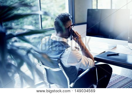 Bearded Businessman Wearing White Shirt Waistcoat Working Modern Loft Startup Computer.Creative Young Man Using Mobile Phone Call Partner Meeting.Person Work Digital Tablet Desktop Table Workplace