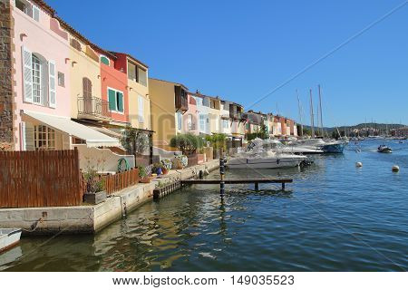 Pretty pastel colored houses on the waterfront in Port Grimaud France