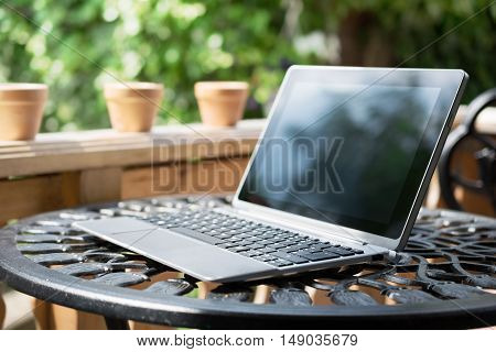 Notebook / Business Tablet With Keyboard Standing On Metal Table Outside