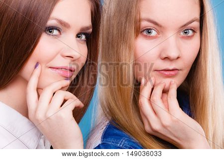 Look results of using cosmetics. Portrait of two girls one with and second without make up. Comparison of natural and cosmetical beauty of women.