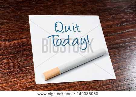 Quit Smoking Today Reminder With Cigarette On Wooden Shelf