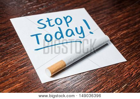 Stop Smoking Today Reminder With Cigarette On Wooden Shelf