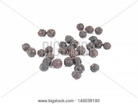 Pepper corn seeds on a white background