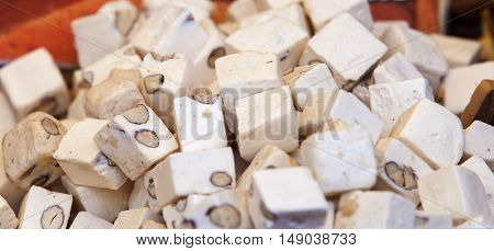 Lot of delicious cubes of spanish soft turron