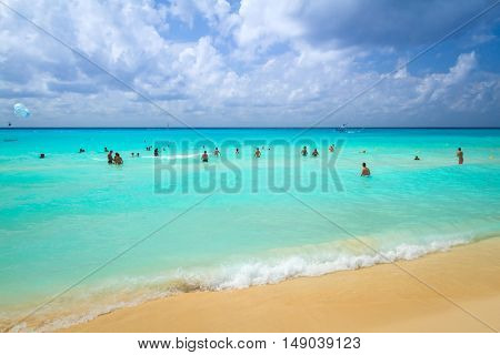 PLAYA DEL CARMEN, MEXICO - JULY 13, 2011: Unidentified tourists on the beach of Playacar at Caribbean Sea of Mexico. This resort area is popular destination with the most beautiful beaches.