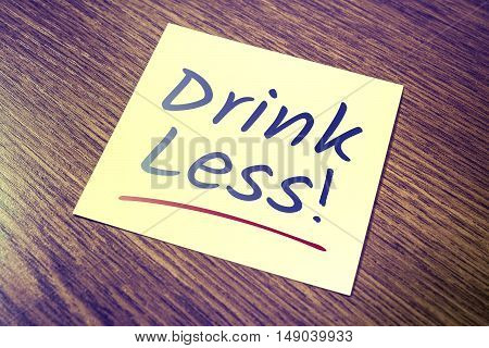 Drink Less Reminder On Paper On Wooden Cupboard