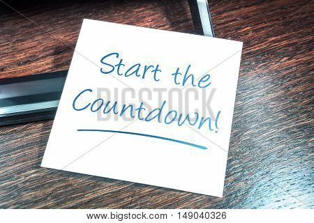 Start The Countdown Reminder On Paper On Wooden Cupboard
