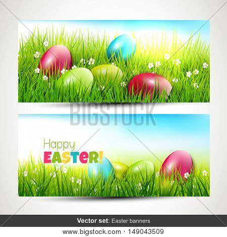 Set of two horizontal Easter banners with eggs in grass