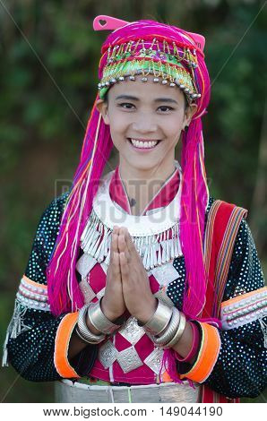 CHIANGMAI,THAILAND - DECEMBER 3, 2014: Unidentified Palaung teenager in the Palaung traditional costume poses for the camera. Palaung people is a minority ethnic group living in northern Thailand.