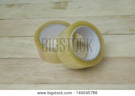 Natural packing scotch tape on wooden texture background