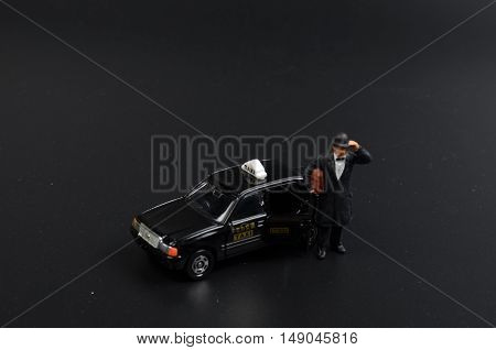 Small Figure With The Japan Taxi