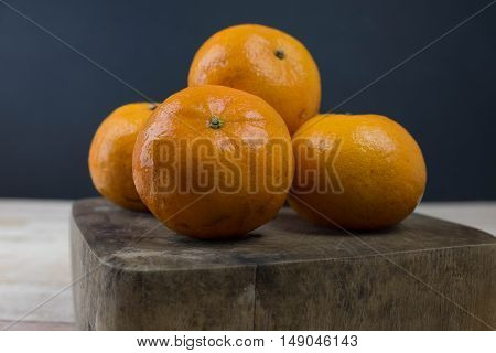 sweet orange in wooden block and black background