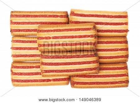Pile of square cookies with jam stripes isolated over the white background