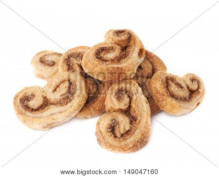 Pile of twisted cookies with cinnamon isolated over the white background