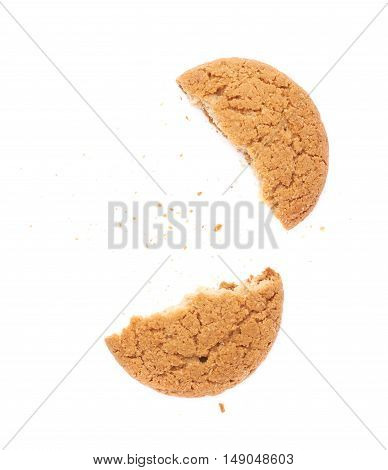 Broken into pieces round cookie isolated over the white background