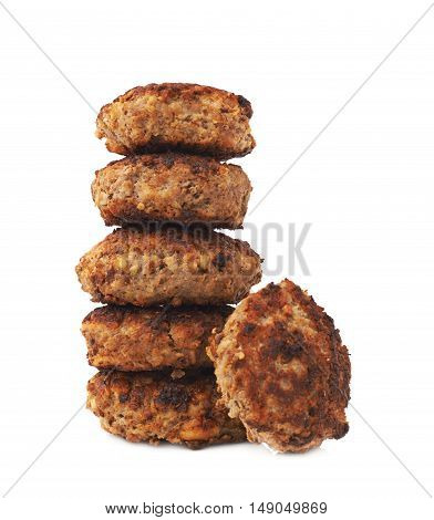 Stack of prepared small hand made cutlets isolated over white background