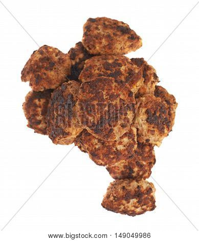 Pile of prepared small hand made cutlets isolated over white background