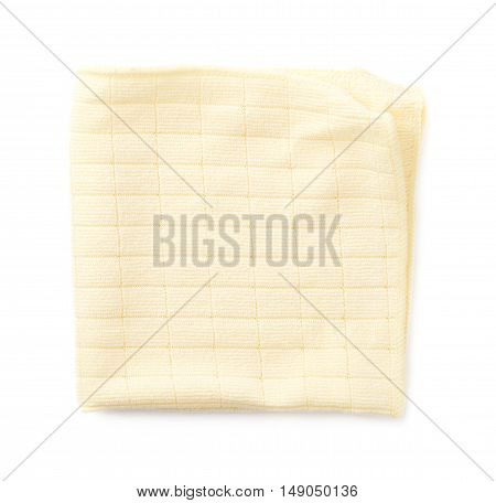 Yellow folded rag over white isolated background