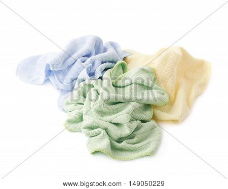Pile of colorful crumpled rags over white isolated background