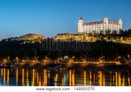 Night view of Bratislava castle in capital city of Slovak republic. with reflections of night lights in the water. Travel photography.