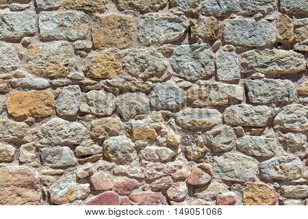 Background from a brown natural stone wall