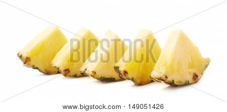 Slices of raw fresh pineapple isolated over white background
