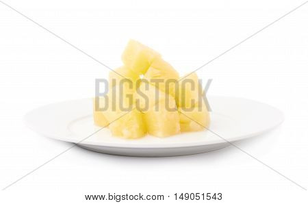 Pile of canned pineapple in plate over isolated white background