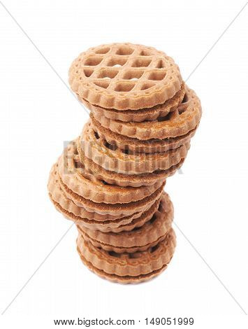 Twisted stack of round cookies with the pieces of chocolate isolated over the white background