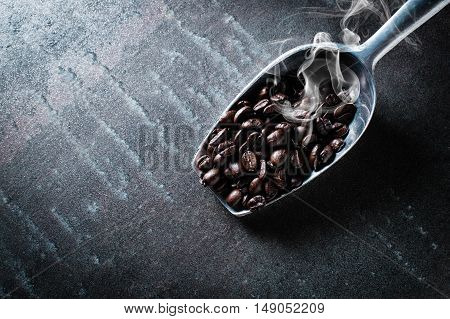 Coffee bean on black stone background.Top view