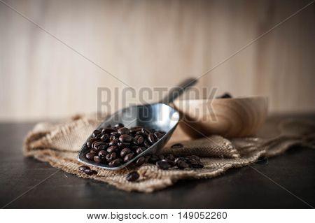 Coffee bean on black stone background.Selective focus