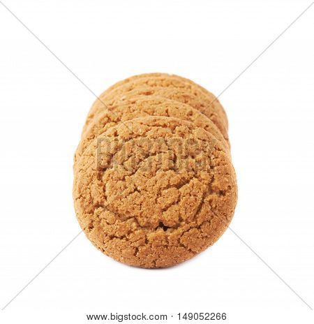 Line of round cookies with the pieces of chocolate isolated over the white background